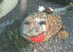Painted rock outside of art studio.